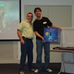 Tony (from Subversive Games) presents Richard with a massive box (containing Altech Lansing speakers)