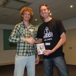 Simon (from Rockethands) presents Graham with a copy of Shadowrun