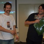 Greg looks happy with his Krumpler laptop bag, and Paul (Black Lab Games) somehow managed to time the prize presentation to coincide with his game (Star Hammer) being on display behind him!