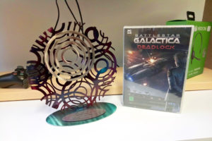 A photograph of a 2017 Australian Game Developer Award sits next to a PC copy of WA-made game Battlestar Galactica Deadlock