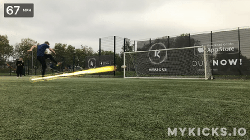 "Link text displayed reads ""MyKicks.io"". The image shows a kicking a soccer ball towards the goals, as a trail of light arches behind the ball. A speed rating of 67 mph sits in the top left corner."