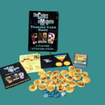 The contents of the tabletop game Coins of McGuffin laid out. The box, tokens, cards, dice and instruction sheet are displayed.