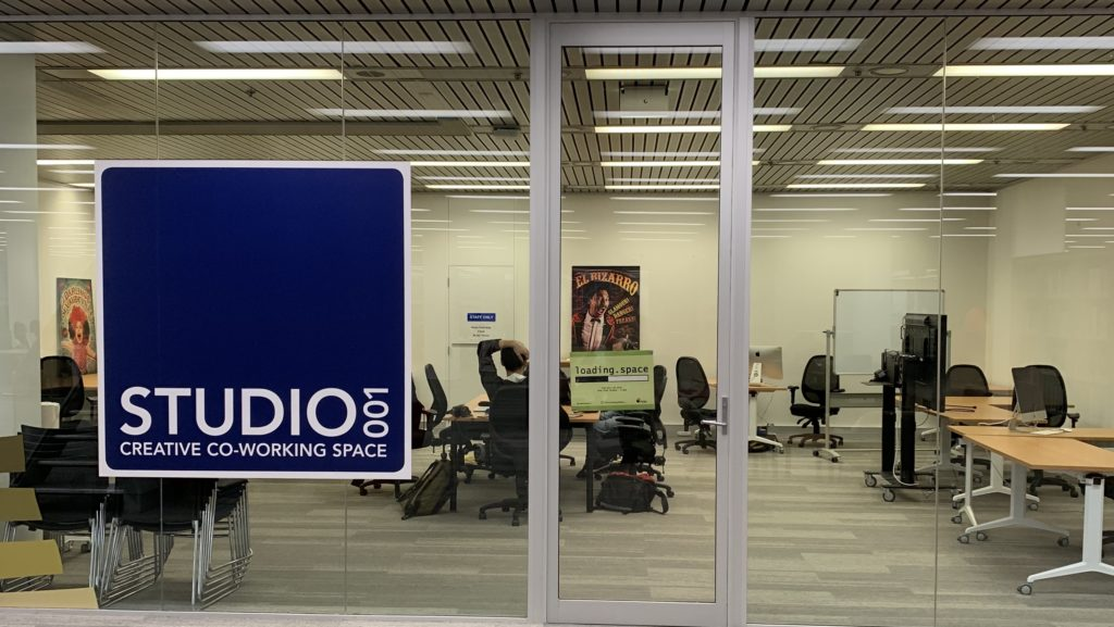 Image Header, photo of the entrance to Studio 001 in the State Library with a sign for Loading Space on the door.