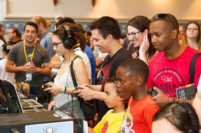 A series of people enthusiastically playing different games
